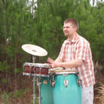 """Matt Groenheide is a percussion performer and educator from Lethbridge, Alberta, Canada. Matt loves the variety that comes from being a percussionist and is well-versed in drumset, world drumming, and classical percussion.  Together with his wife – Jodi Groenheide (flute & percussion) – Matt performs in the <a class=""""jamani"""" href=""""http://www.jamanimusic.com/"""" target=""""_blank""""><strong>jamani duo</strong></a>, a fun and energetic group that blends classical, world, and popular music together on a collection of diverse instruments from around the world.  Matt is the new Director of Worship and Creative Arts at Lethbridge's First Baptist Church.</p>   <p class=""""bio"""">Matt has taught lessons and classes at the University of Southern Mississippi School of Music, at the U of L Conservatory of Music, and as a private instructor.  He teaches clinics and workshops for school bands, community organizations, and other groups.  Matt's favorite time of the year is his summers at MusiCamp Alberta – the premier summer music experience in the province.</p>   <p class=""""bio"""">As a world percussionist, Matt plays and teaches Caribbean steel pans, African percussion and kalimba, Afro-Cuban drumming, Japanese Taiko, Brazilian Samba, Polynesian log drumming, Peruvian cajon, and more.  He performs frequently with the U of L Global Drums Percussion Ensemble.  Matt plays with the Lethbridge Symphony Orchestra (LSO) and was the winner of the 2011 LSO Young Artist Competition.  He has appeared as a concerto soloist with the LSO, the University of Lethbridge (U of L) Wind Orchestra, and the Musaeus string quartet.   As a drumset player, Matt has played with the Afro-Celtic reggae group Dr. Zoo in addition to other folk bands and church worship groups.  His worldwide performances have included Trinidad and Tobago, the Netherlands, London, Japan, Hawai'i, and many parts of Canada and the U.S.</p>  <p class=""""bio"""">As an officer of the Alberta Chapter of the Percussive Arts Society (PAS), Matt has been"""
